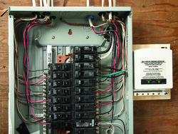 Granite State Electricians - Electric Panel with a home surge protecter