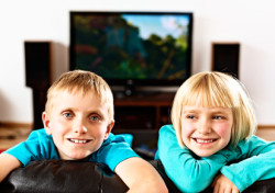 Finishing Touch Home Theater - kids enjoying home theater system
