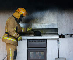 Discount Water Extraction - Man in Fire Damaged Kitchen