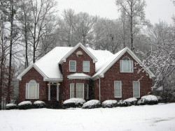 William Arsenault Contracting, LLC -Snow Covered Home