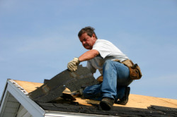William Arsenault Contracting, LLC - Roofing contractor pulling up old shingles