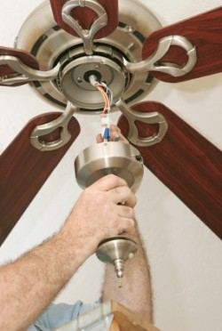 Granite State Electricians - Electrician installing a cieling fanl