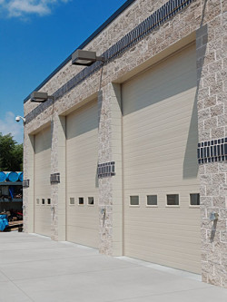 Forgatch Overhead Doors - Three Garage Doors on Commercial Building