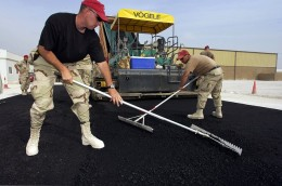 Richard Paving, Inc. - Men working hard paving
