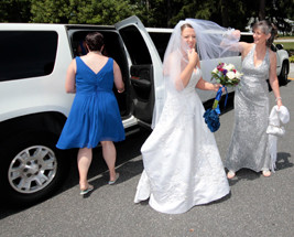 Endeavor Limousines -Excited bride and her wedding limo