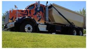 Tiger Sanitation LLC - Large Truck With Tan Dumpster