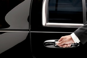 Noble Transportation & Limousines - Chauffeur Opening a Car Door