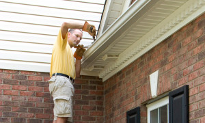 Mike's Window and Gutter Cleaning - Cleaning Out Rain Gutters