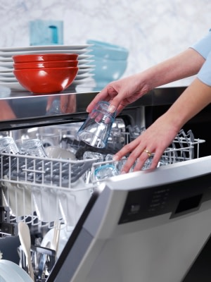 Fifth Avenue Appliance Service -A Woman Loading the Dishwasher