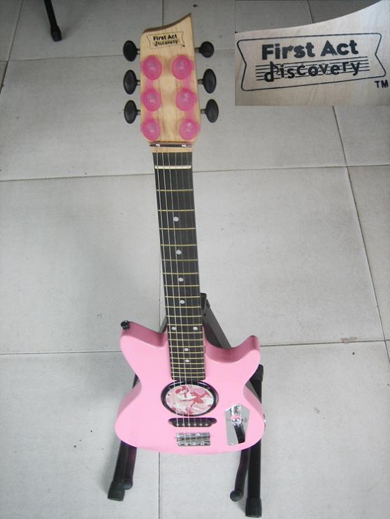 First act discovery pink guitar