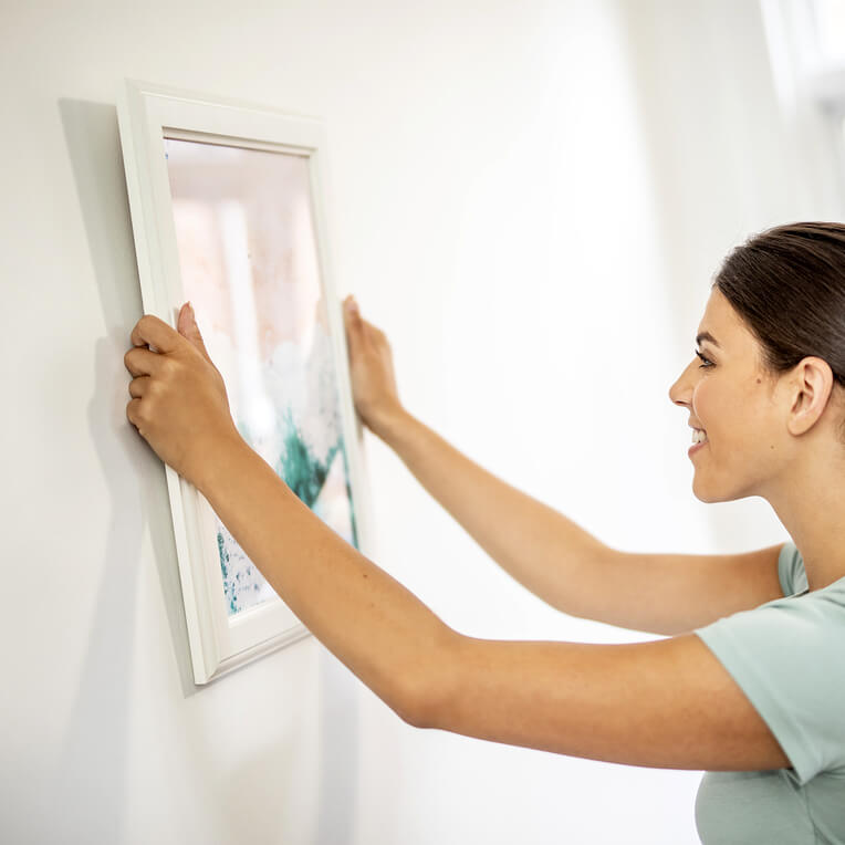 Last but not least, place your picture back on the wall and make any adjustments that you need to.