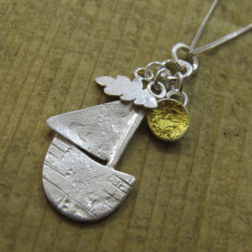 Sun, cloud and boat charm necklace
