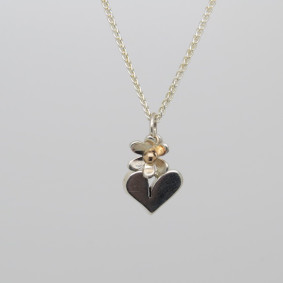 Heart and flower necklace.