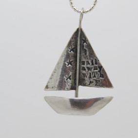 Sail away with me boat necklace.