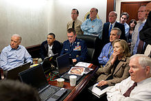 President Barack Obama and Vice President Joe Biden, along with members of the national security team, receive an update on Operation Neptune's Spear, a mission against Osama bin Laden, in one of the conference rooms of the Situation Room of the White House, on May 1, 2011. They are watching live feed from drones operating over the bin Laden complex.