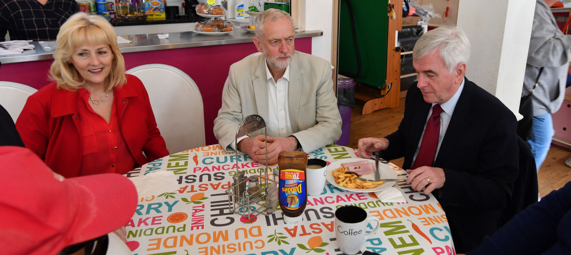 Jeremy Corbyn, John McDonnell and Jennie Formby sit at a cafe while campaigning in local elections.
