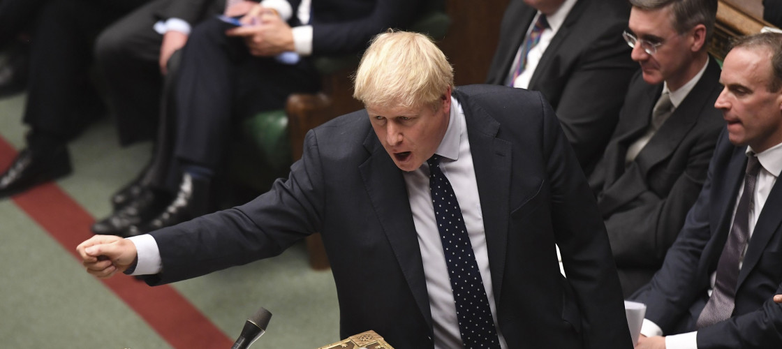British Prime Minister Boris Johnson (front) attends the debate of the Queen's Speech
