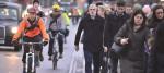 Commuters cross Waterloo Bridge in London