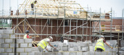 Builders lay blocks on a building site near Bristol,