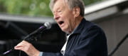 Lord Alf Dubs on stage addressing the crowd during a rally in Parliament Square, London, after taking part in the Refugees Welcome March