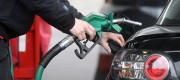 A man filling a car with fuel