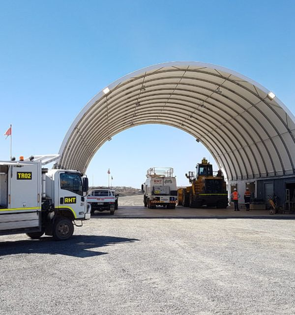 Heavy machinery and vehicles stored under DomeShelter.