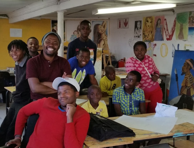 The students at Sapebuso Primary School with Nkosana Ngobese.