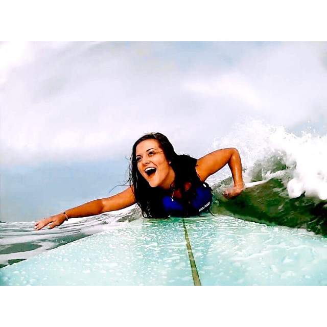 Student Brittney Seekell paddles to pop up on her hand crafted board!