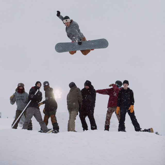Student Brett Kulas gets big air over his homies on his handcrafted snowboard!