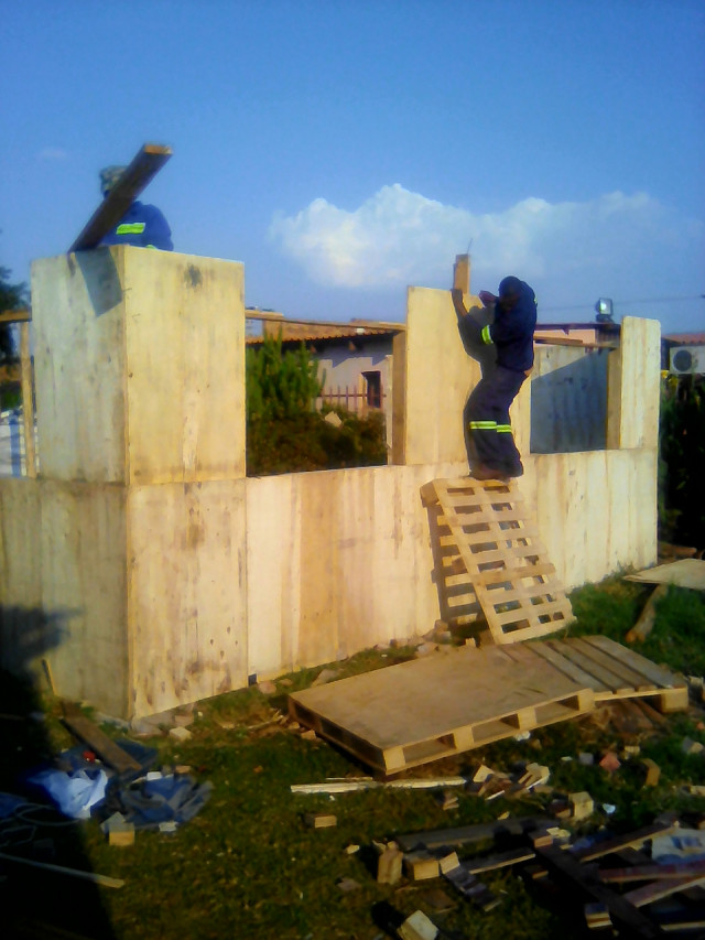 Converting waste wooden pallets to wendy house