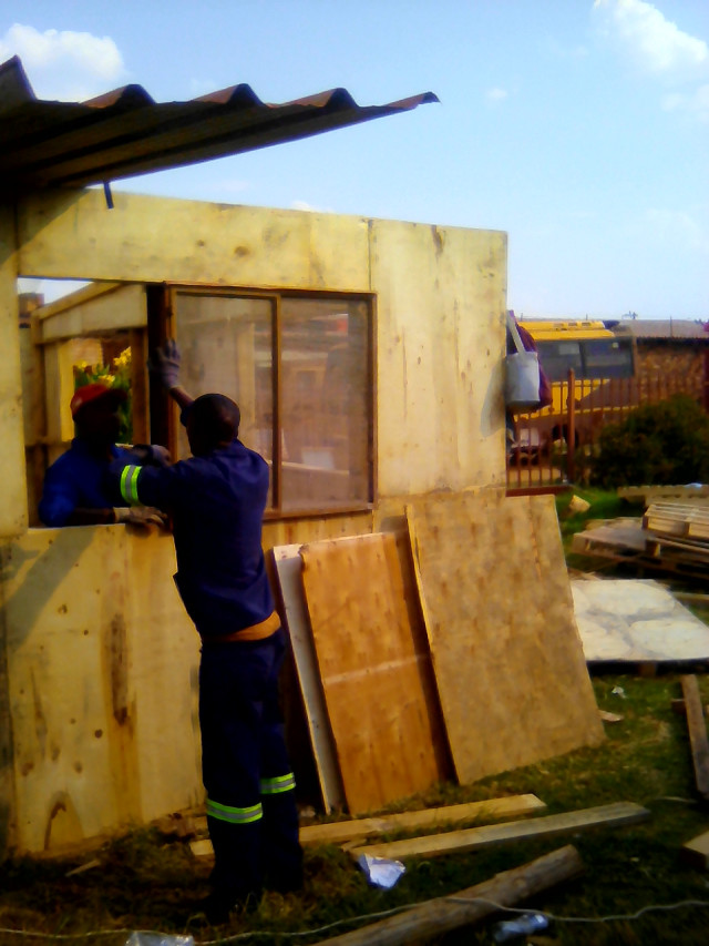 construction of our ablution facilities using recycled wooden pallets