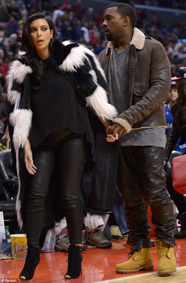 Hiding a bump: The couple at the LA Clippers game on Christmas Day