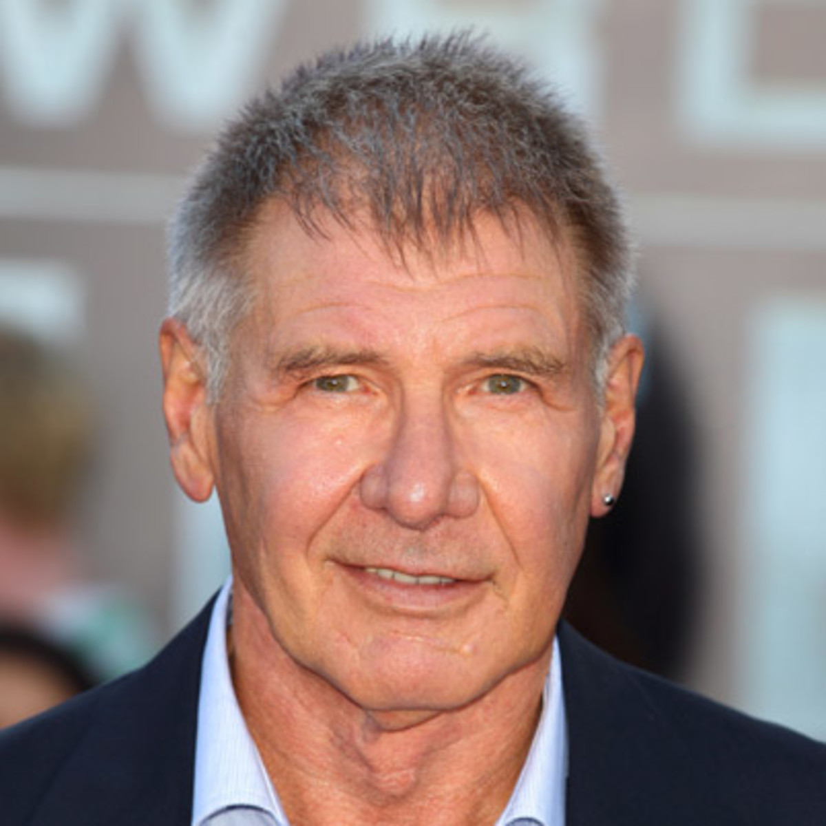Who was harrison ford married to