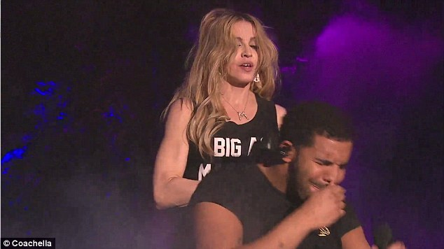 In pain: Though Madonna didn't see his expression, he clearly was in pain over the experience