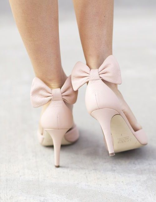 Pink heels with bow on back
