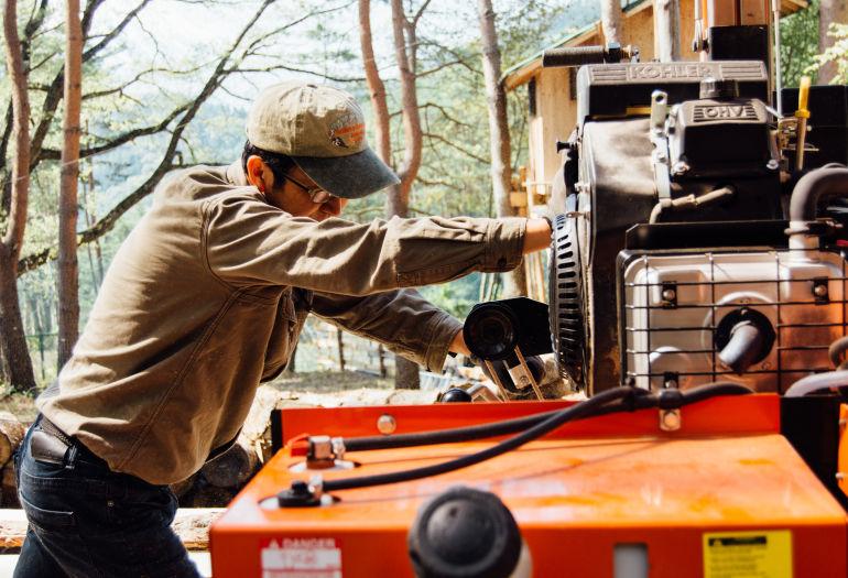 Woodworker Tak Yoshino using LT15 sawmill