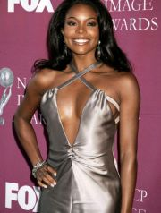 Actress Gabrielle Union poses for photographers at the 36th NAACP Image Awards in Los Angeles, March 19, 2005. Union was a presenter at the awards show. The awards, presented by the National Association for the Advancement of Coloured People, honour people of colour in the entertainment industry, and will be telecast in the United States on the Fox television network March 25. REUTERS/Fred Prouser NAACP IMAGE AWARDS