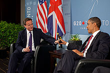 US President Barack Obama and British Prime Minister David Cameron trade bottles of beer to settle a bet they made on the U.S. vs. England World Cup Soccer game (which ended in a tie), during a bilateral meeting at the G20 Summit in Toronto, Canada, Saturday, June 26, 2010.