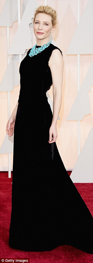 Striking: The floor-length frock, with light feathered detailing around the shoulders, could be seen sweeping along the red carpet behind her as she held onto a simple black clutch