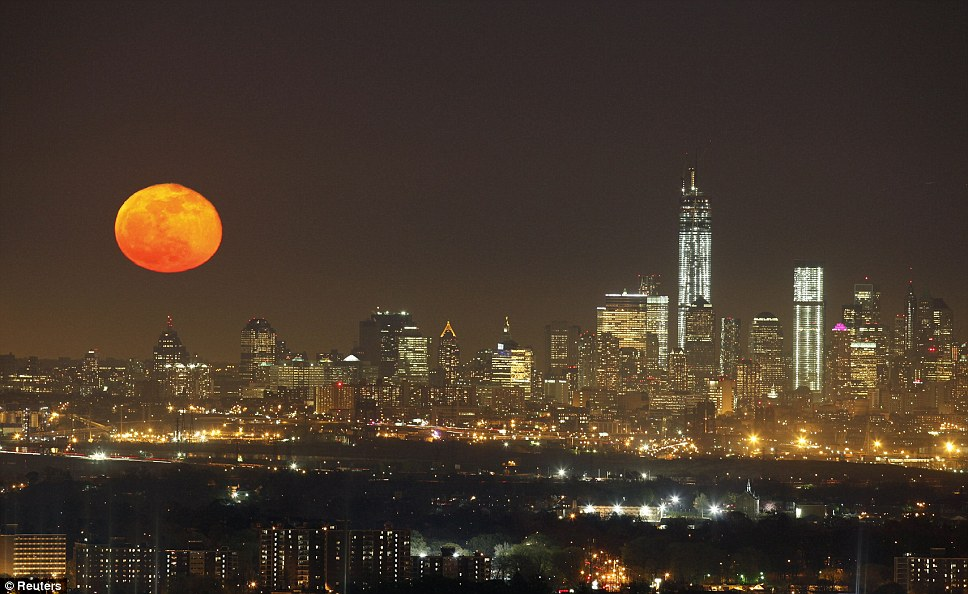'Pink' moon: A full moon rises over the skyline of New York next to One World Trade Center in Lower Manhattan, as seen from the Eagle Rock Reservation in West Orange