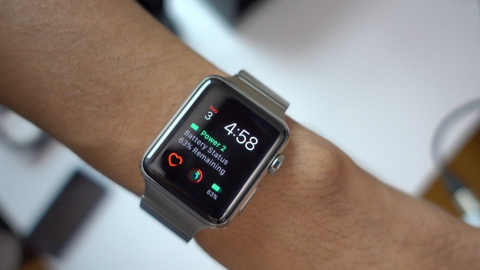 Watch face with several complications: calendar, battery (main complication), heart app, activity, and again battery