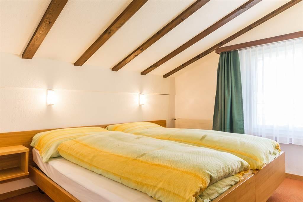 Am Vogelwald 2-ZW Dachwohnung Schlafzimmer