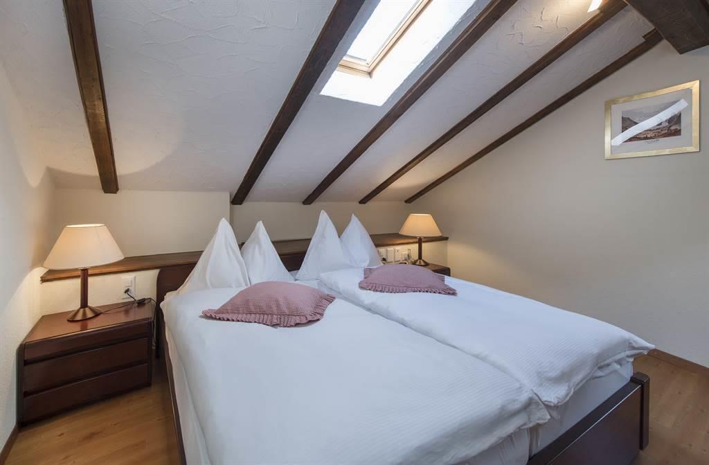 Suite 1_Schlafzimmer_Sunstar Hotel Saas-Fee_Origin