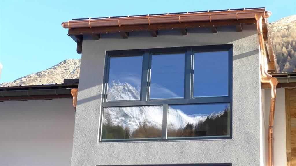 Haus Amici, Westen - Spiegelbild der Berge