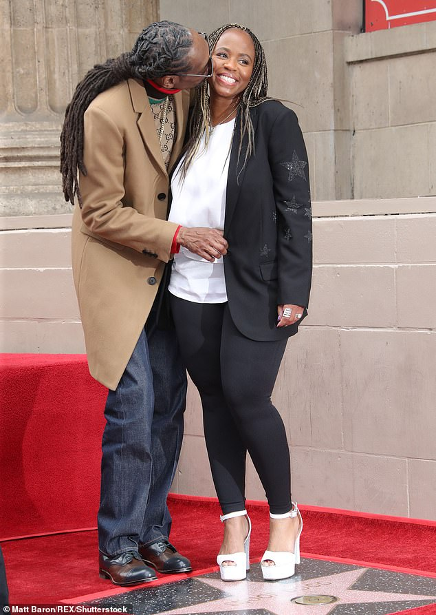 In it for the long haul:Snoop Dogg kisses his wife of 21 years Shante Taylor as he gets a star on Hollywood Walk of Fame in Los Angeles on Monday