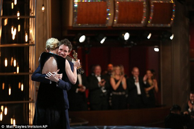Congratulations: The mother-of-three couldn't have been happier to hand over the award to the Theory Of Everything star