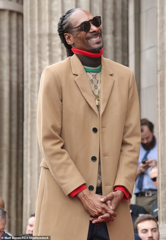 Nuthin' but a G Thang:Donning a long tan coat with a beige turtleneck underneath, the Gin and Juice rapper couldn't keep the smile from his face