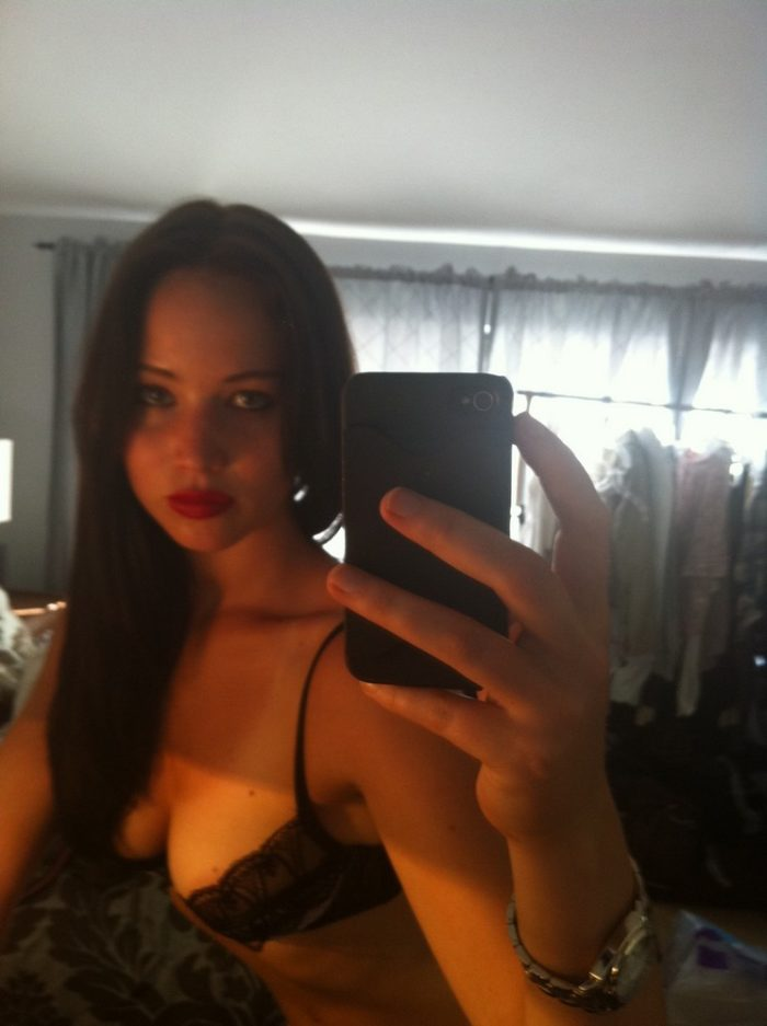 Jlaw takes a pic of herself with dark hair and black bra