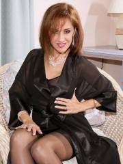Brunette pantyhose floozy wears stockings and garter