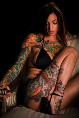 Woman with many tattoos